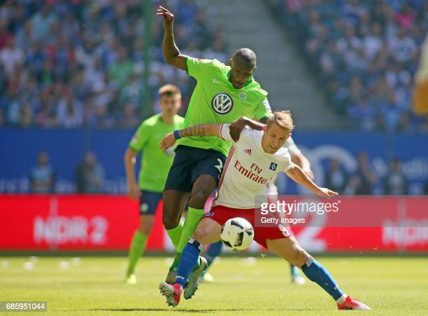 Lewis Holtby of HSV fights for the ball with Josuha Guilavogui of Wolfsburg during the Bundesliga match between Hamburger SV and VfL Wolfsburg at...