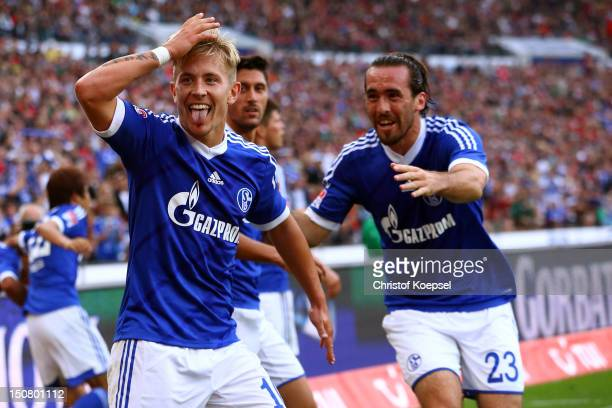Lewis Holtby of Schalke celebrates the second goal with Christian Fuchs during the Bundesliga match between Hannover 96 and FC Schalke 04 at AWD...