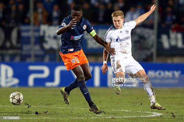 Lewis Holtby of Schalke challenge Mapou Yanga-Mblawa of Montpellier during the UEFA Champions League group B match between Montpellier Herault SC and...