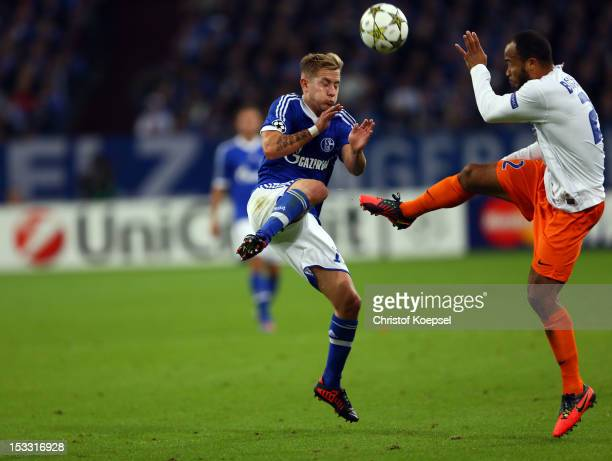 Lewis Holtby of Schalke challenges Garry Bocaly of Montpellier during the UEFA Champions League group B match between FC Schalke 04 and Montpellier...
