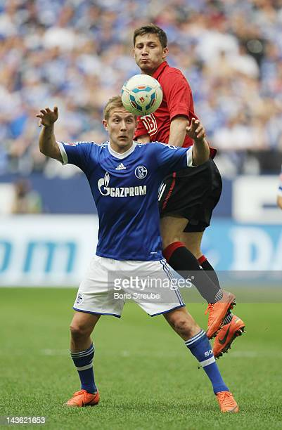Lewis Holtby of Schalke jumps for a header with Tunay Torun during the Bundesliga match between FC Schalke 04 and Hertha BSC Berlin at Veltins Arena...