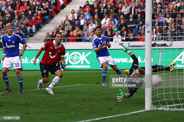 Lewis Holtby of Schalke scores the scores the second goal against RonRobert Zieler of Hannover during the Bundesliga match between Hannover 96 and FC...