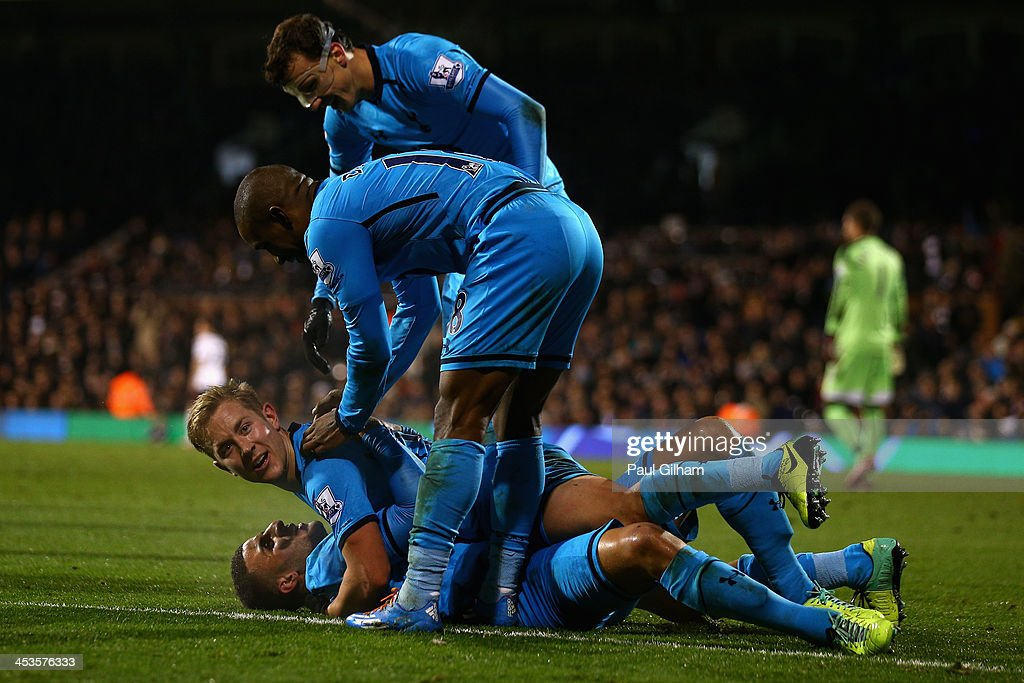 Lewis Holtby of Tottenham Hotspur celebrates with his team-mates after scoring the second and winning goal for Tottenham Hotspur during the Barclays Premier League match between Fulham and Tottenham Hotspur at Craven Cottage on December 4, 2013 in London, England.