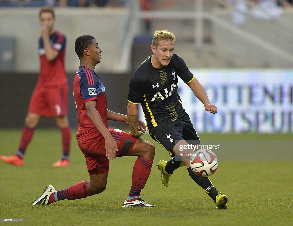 Lewis Holtby #14 of Tottenham Hotspur (R) moves the ball as Grant Ward #8 of the Chicago Fire defends during the first half at Toyota Park on July 26, 2014 in Bridgeview, Illinois. Tottenham Hotspur defeated the Fire 2-0.