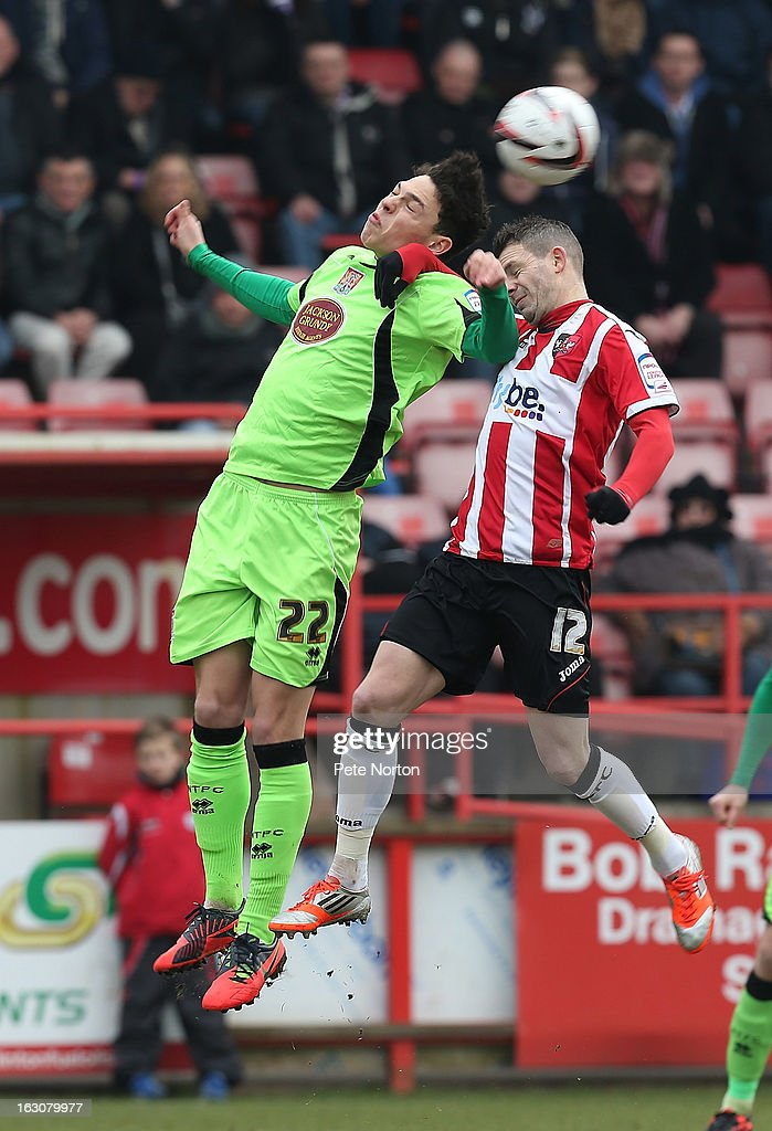 Lewis Hornby (L) of Northampton Town contests the ball with Jamie Cureton of Exeter City during the npower League Two match between Exeter City and Northampton Town at St James's Park on March 2, 2013 in Exeter, England.