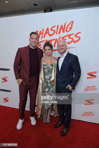 Lewis Howes and Amanda Cerny and Johannes Bartl attend Lewis Howes Documentary Live Premiere Chasing Greatness at Pacific Theatres at The Grove on...