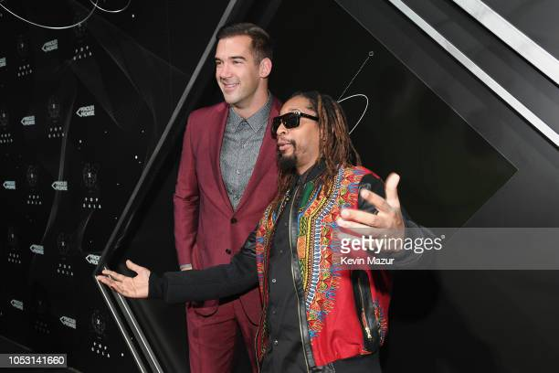 Lewis Howes and Lil Jon attend the Pencils of Promise 10th Anniversary Gala at the Duggal Greenhouse on October 24 2018 in New York City