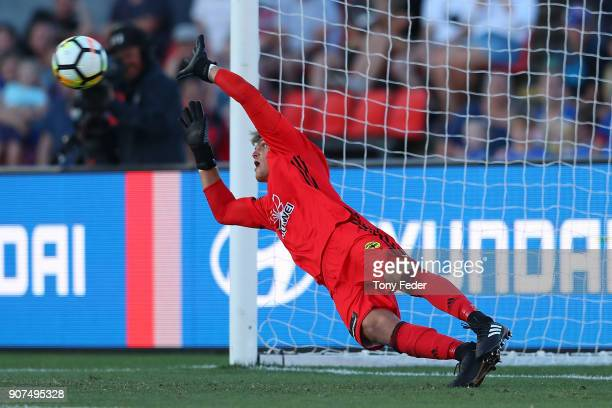 Lewis Italiano of the Phoenix dives to try and save a penalty during the round 17 ALeague match between the Newcastle Jets and Wellington Phoenix at...