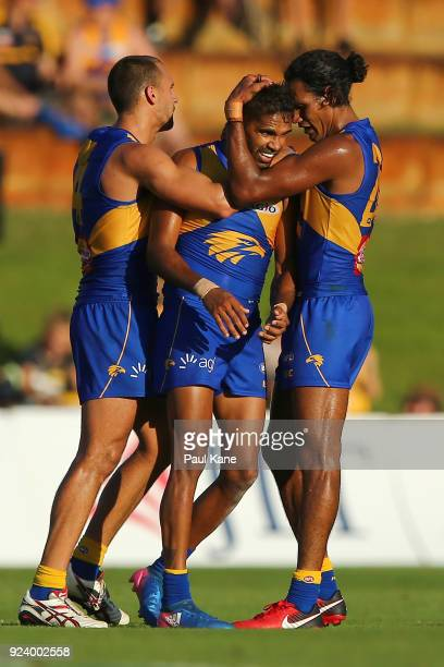 Lewis Jetta of the Eagles is congratulated by Dom Sheed and Francis Watson after kicking a goal late in the 4th quarter during the JLT Community...