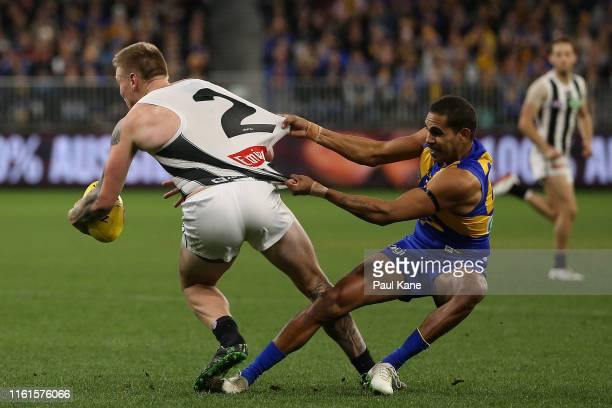 Lewis Jetta of the Eagles tackles Jordan De Goey of the Magpies during the round 17 AFL match between the West Coast Eagles and the Collingwood...
