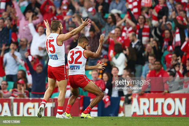 Lewis Jetta of the Swans celebrates scoring a goal during the round 18 AFL match between the Sydney Swans and the Adelaide Crows at Sydney Cricket...
