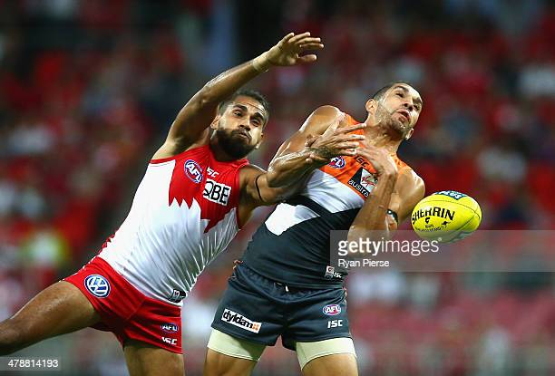 Lewis Jetta of the Swans competes for the ball against Curtly Hampton of the Giants during the round one AFL match between the Greater Western Sydney...