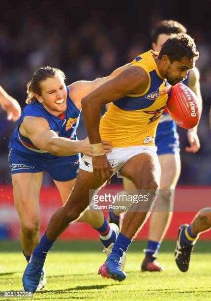 Lewis Jetta of the Swans is tackled by Marcus Bontempelli of the Bulldogs during the round 15 AFL match between the Western Bulldogs and the West...