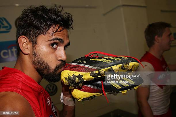 Lewis Jetta of the Swans kisses his Indigenous coloured boots made for Indigenous Round during an AFL match between the Collingwood Magpies and the...