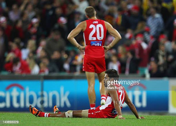 Lewis Jetta of the Swans looks dejected as he sits on the field after defeat during the round six AFL match between the Sydney Swans and the Adelaide...