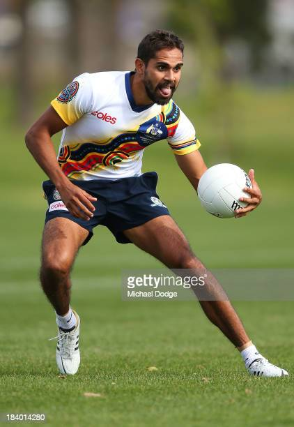 Lewis Jetta runs with the ball during an Indigenous Australian International Rules Team training session at Gosch's Paddock on October 11, 2013 in...