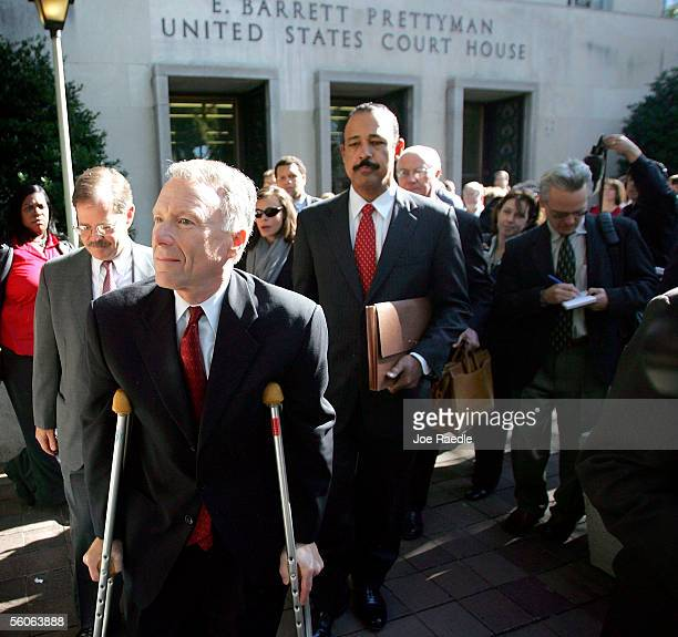 I Lewis Libby Vice President Dick Cheneys former top aide leaves the Federal courthouse on crutches followed by his defense attorneys William...