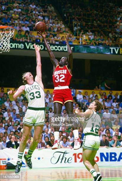 Lewis Lloyd of the Houston Rockets shoots over Larry Bird of the Boston Celtics during an NBA basketball game circa 1984 at The Boston Garden in...