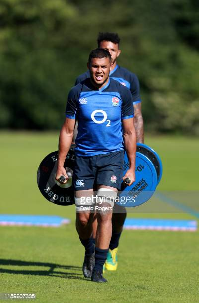 Lewis Ludlam and Courtney Lawes work out as they carry weight bars during the England training session held at the Lensbury Club on July 02 2019 in...
