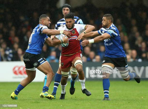 Lewis Ludlam of Northampton is tackled by Joe Cokanasiga and Taulupe Faletau during the Gallagher Premiership Rugby match between Bath Rugby and...