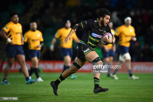 Lewis Ludlam of Northampton Saints breaks through to score a try during the Challenge Cup match between Northampton Saints and Timisoara Saracens at...