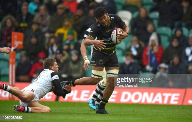 Lewis Ludlam of Northampton Saints is tackled by Tom Pincus of Bristol Bears during the Premiership Rugby Cup match between Northampton Saints and...