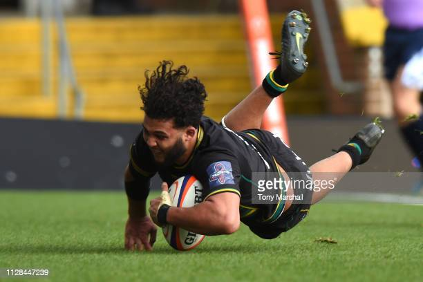 Lewis Ludlam of Northampton Saints scores their third try during the Premiership Rugby Cup Semi Final match between Northampton Saints and Newcastle...