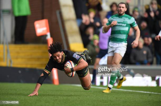 Lewis Ludlam of Northampton Saints scoring their third try during the Premiership Rugby Cup Semi Final match between Northampton Saints and Newcastle...