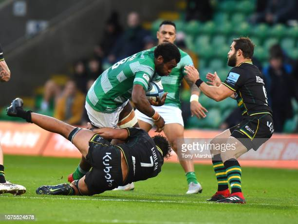 Lewis Ludlam of Northampton Saints tackles Nemani Nagusa of Newcastle Falcons during the Gallagher Premiership Rugby match between Northampton Saints...
