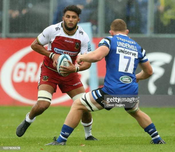 Lewis Ludlam of Northampton takes on Sam Underhill during the Gallagher Premiership Rugby match between Bath Rugby and Northampton Saints at the...