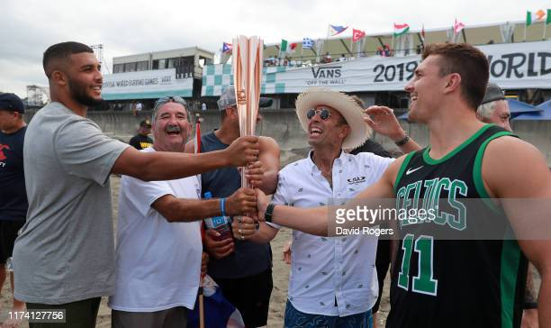 Lewis Ludlam, Rob Green, the British surfing team manager, Jonathan Joseph, Fernando Aguerre, the International Surfing Association president, and...