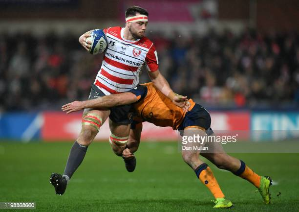 Lewis Ludlow of Gloucester is tackled by Henry Immelman of Montpellier during the Heineken Champions Cup Round 5 match between Gloucester Rugby and...