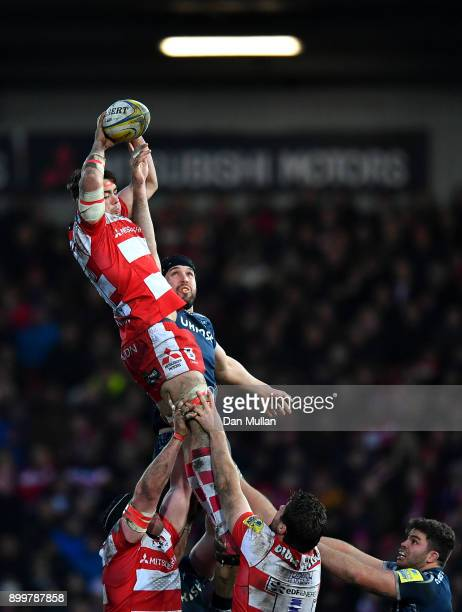 Lewis Ludlow of Gloucester rises to claim the lineout ahead of Andrei Ostrikov of Sale Sharks during the Aviva Premiership match between Gloucester...