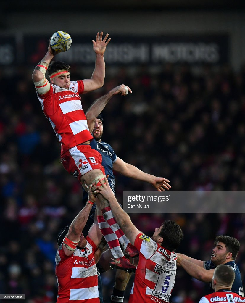 Lewis Ludlow of Gloucester rises to claim the lineout ahead of Andrei Ostrikov of Sale Sharks during the Aviva Premiership match between Gloucester Rugby and Sale Sharks Sharks at Kingsholm Stadium on December 30, 2017 in Gloucester, England.