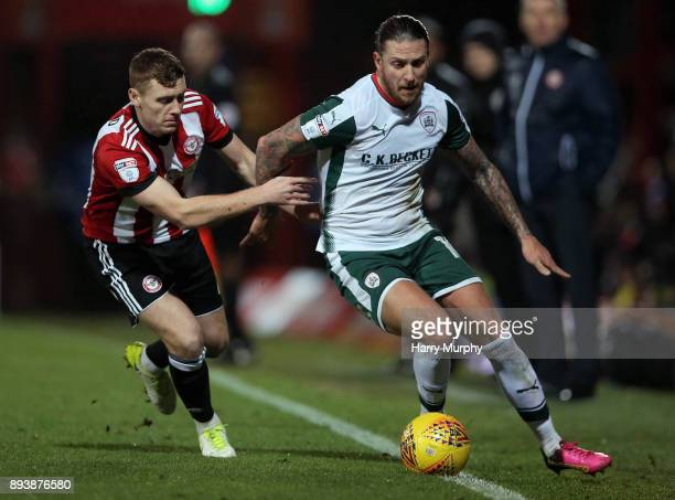 Lewis MacLeod of Brentford and George Moncur of Barnsley vie for the ball during the Sky Bet Championship match between Brentford and Barnsley at...