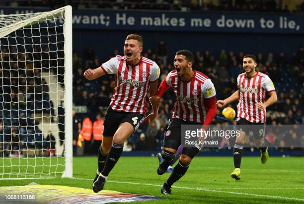 Lewis MacLeod of Brentford celebrates after scoring his team's first goal with team mates Said Benrahma during the Sky Bet Championship match between...