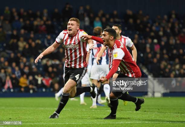 Lewis MacLeod of Brentford celebrates after scoring his team's first goal with team mate Said Benrahma during the Sky Bet Championship match between...