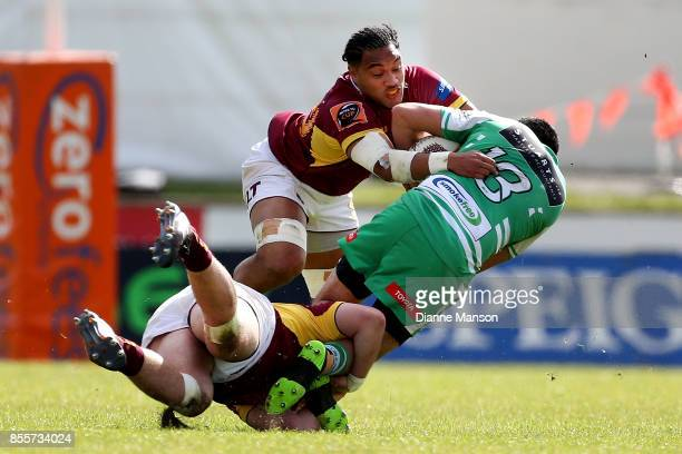 Lewis Marshall of Manawatu is tackled by Flynn Thomas and Tupou Sopoaga of Southland during the round seven Mitre 10 Cup match between Southland and...