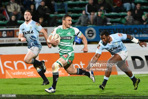 Lewis Marshall of Manawatu runs away from Jone Macilai of Northland to score a try during the round six Mitre 10 Cup match between Manawatu and...