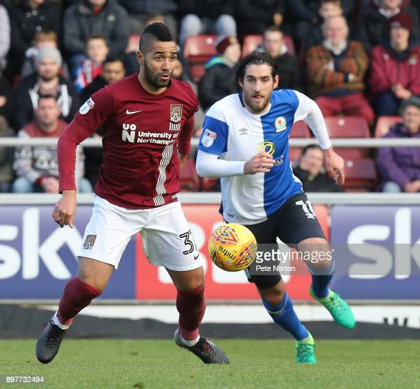 Lewis McGugan of Northampton Town moves forward with the ball away from Danny Graham of Blackburn Rovers during the Sky Bet League One match between...