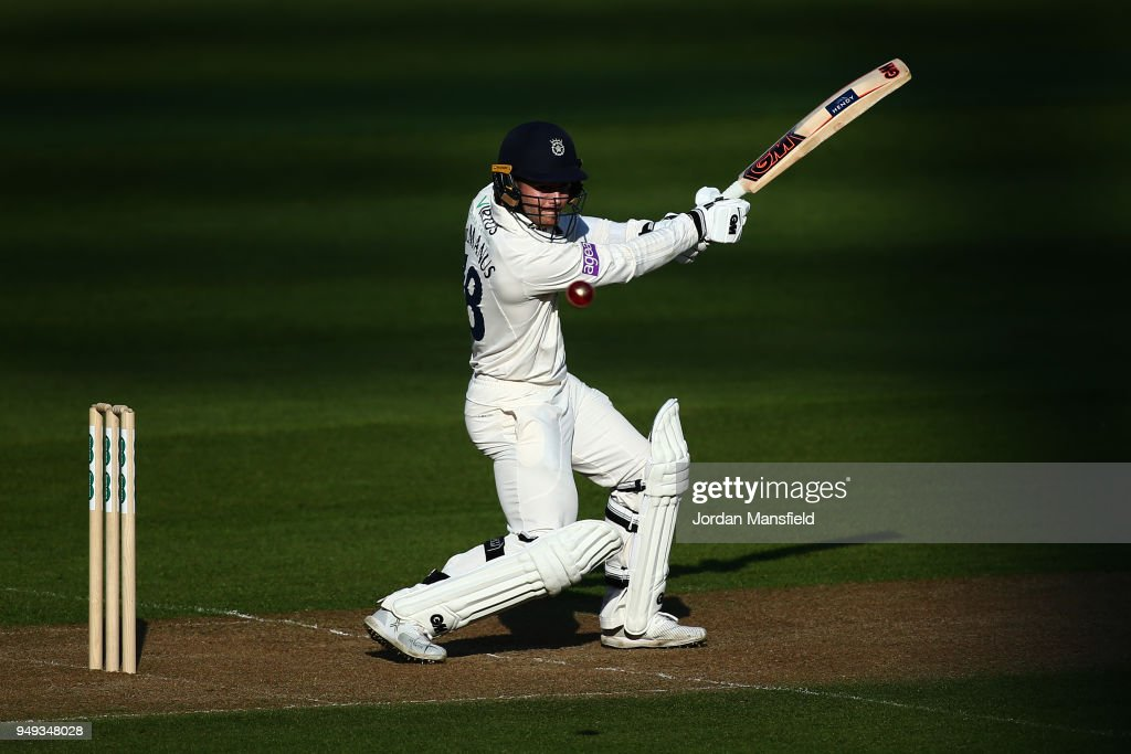 Lewis McManus of Hampshire hits out during day one of the Division One Specsavers County Championship match between Surrey and Hampshire at The Kia Oval on April 20, 2018 in London, England.