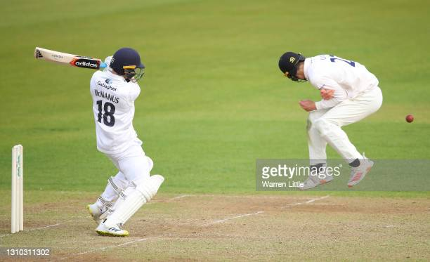 Lewis McManus of Hampshire pulls the ball past Tom Clark of Sussex during a pre-season warm up match between Sussex and Hampshire at Ageas Bowl on...