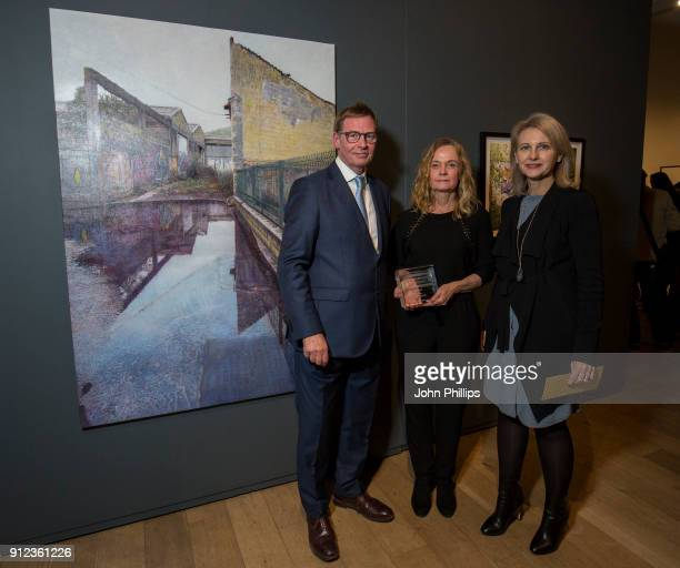 Lewis McNaught Director Mall Galleries and Alison Jefferis Head of Corporate Affairs Columbia Threadneedle Investments with Ana Schmidt winner of the...