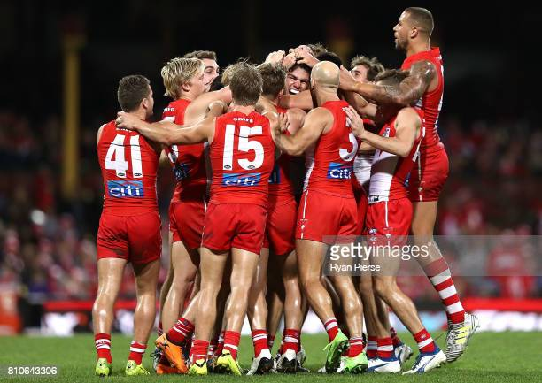 Lewis Melican of the Swans celebrates his first AFL goal during the round 16 AFL match between the Sydney Swans and the Gold Coast Suns at Sydney...