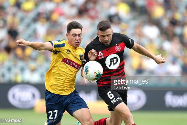 Lewis Miller of the Central Coast Mariners contests the ball with Matthew Jurman of Western Sydney Wanderers during the round 17 A-League match...