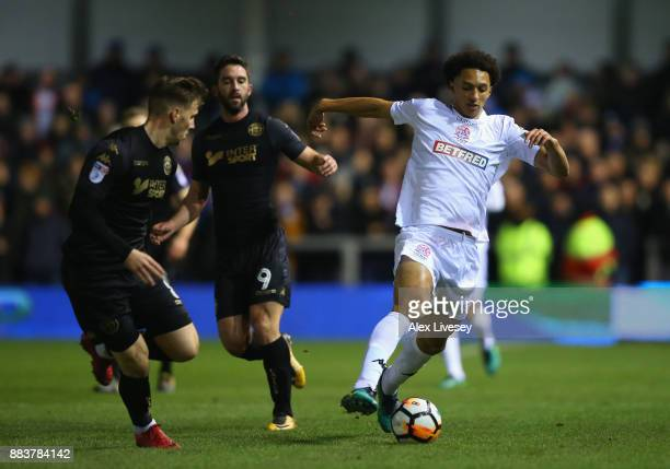 Lewis Montrose of AFC Fylde turns from Lee Evans of Wigan Athletic during The Emirates FA Cup Second Round between AFC Fylde and Wigan Athletic on...