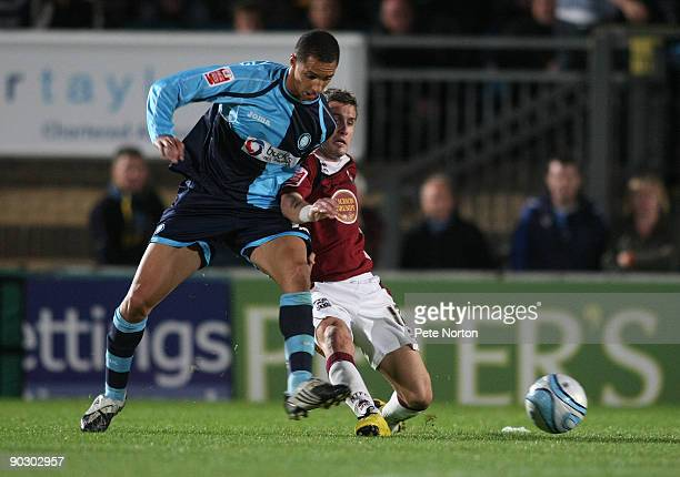 Lewis Montrose of Wycombe Wanderers contests the ball with Ryan Gilligan of Northampton Town during the Johnstone's Paint Trophy First Round Match...