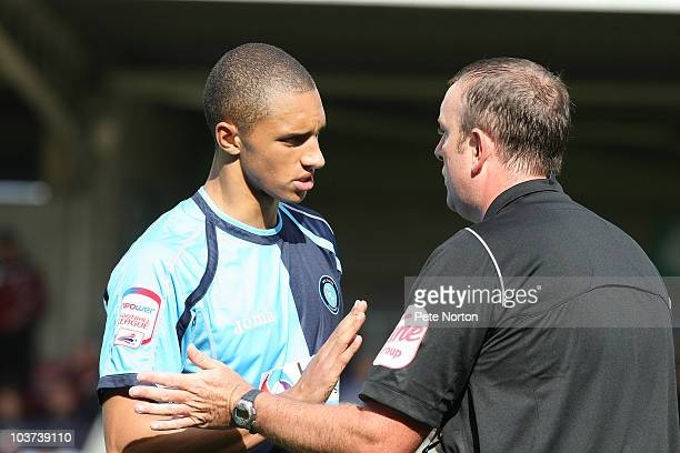 Lewis Montrose of Wycombe Wanderers makes a point to referee Carl Boyeson during the npower LeagueTwo match between Northampton Town and Wycombe...