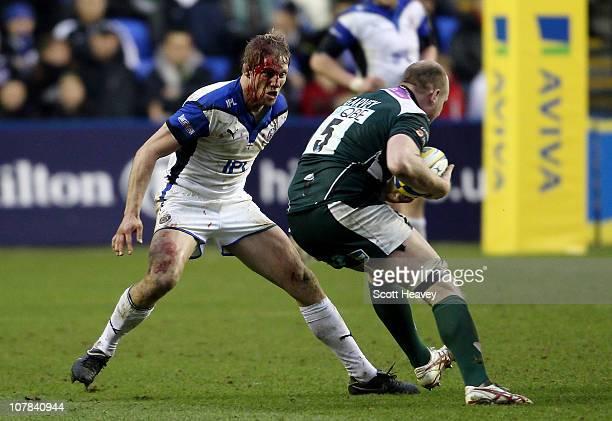 Lewis Moody of Bath prepares to tackle Matt Garvey of London Irish during the Aviva Premiership match between London Irish and Bath Rugby at Madejski...