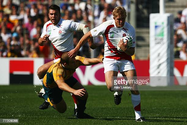 Lewis Moody of England goes past Stephen Moore of Australia during the Quarter Final of the Rugby World Cup 2007 between Australia and England at the...